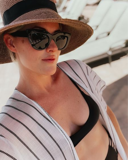 Loving this new cover up! Wear it loose or tied in the front. I wear a M in my swimsuit tops & bottoms. #LTKunder50 #LTKswim #coverup #stripes #bikini #blackswimsuit #swimsuit #sunhat #sunglasses #hat #cateyesunglasses #sunnies #summerstyle #pool #beach #vacay #amazonfashion #founditonamazon #amazonfinds #targetstyle #liketkit @liketoknow.it http://liketk.it/3gR3A