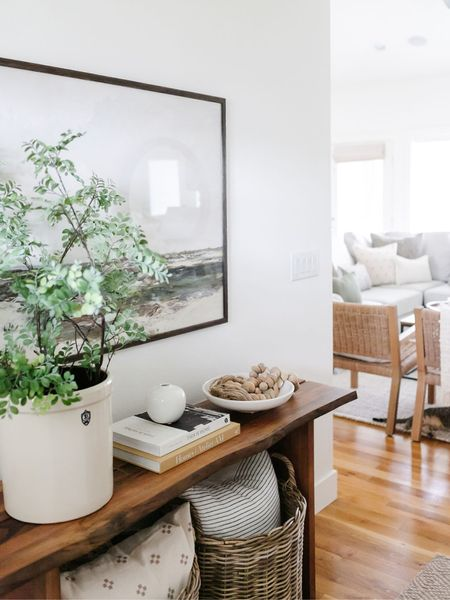 Entryway table decor inspiration. Etsy pillows and artwork, Target baskets, Workd Market console table.  Amazon finds, Target style.    You can instantly shop all of my looks by following me on the LIKEtoKNOW.it shopping app http://liketk.it/3jEve #liketkit @liketoknow.it #LTKunder50 #LTKunder100 @liketoknow.it.home