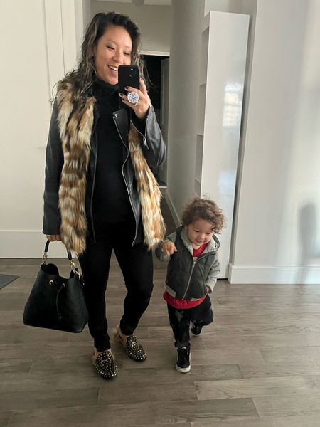 When it's 50 degrees in NYC, we layer. Faux fur vest over a leather jacket. Black turtlenesck. Skinny jeans. Black bucket bag. Bump outfit. Fall outfit. Winter outfit. Workwear.  #LTKbump #LTKworkwear #LTKkids