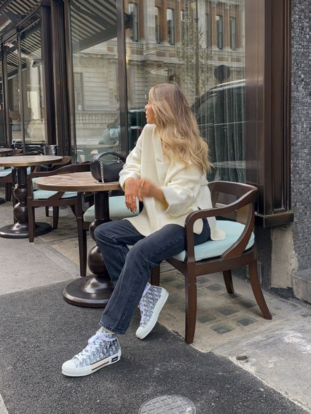 Oversized knits and dad jeans are always such an easy go to! I love this pretty lavish v neck knit teamed with these topshop dad jeans for a casual autumnal look! I have finished the outfit off with a pair of dior trainers and my by far bag     #LTKeurope
