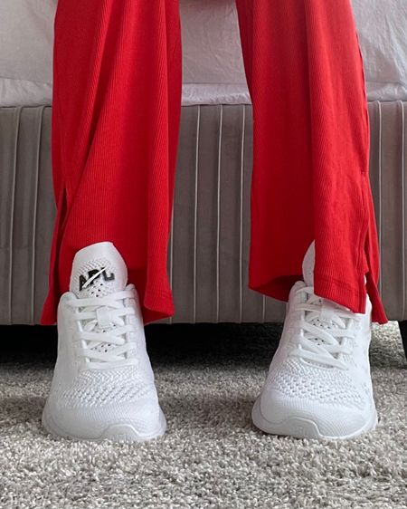 Best sneakers of the moment, favorite shoes, must have sneakers for summer, red two-piece lounge set, year of ours, white sneakers, white gym shoes, apls, apl sneakers, comfy walking shoes, comfortable and cute sneakers, cute running shoes, revolve, crop top, bralette, flare pants, slit pants, comfy pants, ribbed pants, ribbed tank, high waisted pants, rib knit top, cute loungewear, activewear, patriotic outfit, ootd, bright red pants, Memorial Day weekend, 4th of July, red crop top, red outfit, patriotic outfit inspiration, cute sporty look, red sports bra, revolve girl, revolve fashion http://liketk.it/3fNMt  @liketoknow.it #liketkit #LTKunder100 #LTKstyletip #LTKfit