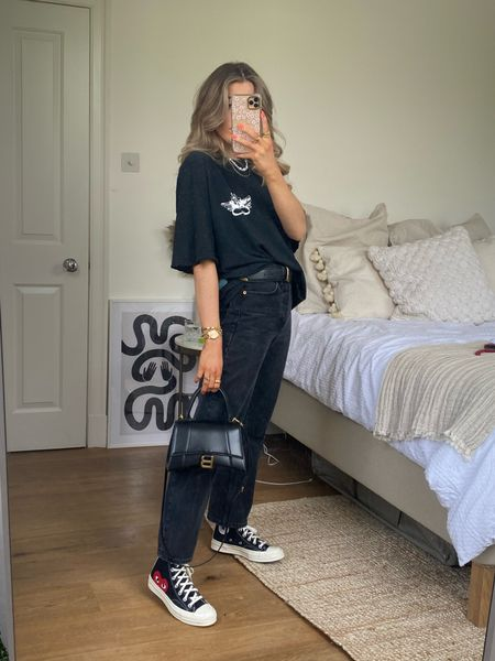 Oversized black tee and dad jeans is my go to look at the moment! Teamed with my come des garçons converse and balenciaga hourglass bag      #LTKeurope #LTKSeasonal