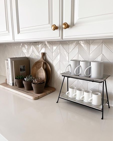 Kitchen counter decor, cook books, wood serving boards, cutting boards, clay pots, succulents, amazon finds, linking similar items to help you recreate this look, stylinaylinhome @liketoknow.it #liketkit http://liketk.it/3hUNu           #LTKhome #LTKstyletip #LTKunder50