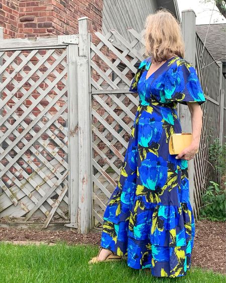Have you seen the latest designer summer dresses collaboration at Target? I fell in love with the Christopher John Rogers floral midi and maxi dresses. This blue Floral Puff Sleeve Tiered Dress is so comfortable! The dress seemed a bit heavy until I put it on. The sleeves are light and airy and the fabric is a good quality. It is very well constructed with a hidden side zipper and pockets! It fits true to designer size and also comes in Plus Sizes. Check out the other bold florals in this collection. They are all $60 or less, and this blue dress is only $55.  #LTKstyletip #LTKSeasonal #LTKunder100