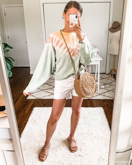 This Walmart tie dye sweatshirt is on clearance for just $6! It's such a gem, reminds me of a similar style by Free People. Features dolman sleeves and cropped styling, I'm wearing a large (so I went up two sizes for a loose fit). http://liketk.it/3kfhy #liketkit @liketoknow.it #LTKsalealert #LTKunder50 #walmartfashion #walmartfinds #tiedye #scoopnyc