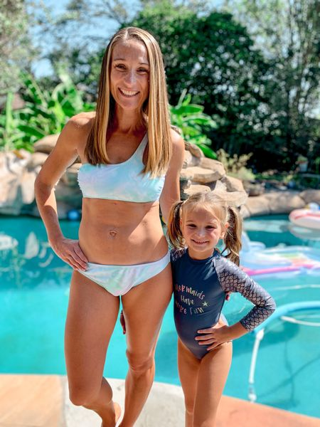 Summer may be over but that means you'll probably find some steals on swimwear! Check out these cute one shoulder bikinis for women and long sleeve rash guard swimsuits for girls.  #LTKSeasonal #LTKswim #LTKsalealert