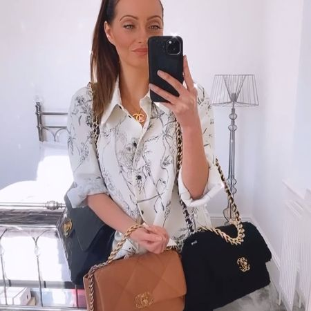 Styling three stunning Chanel bags with this simple printed blouse and black jeans combination 🙌  Bags featured: Chanel caramel 19 small Chanel large 19 black tweed Chanel vintage jumbo classic flap bag   #chanelbag #chanelclassicflap #chanel19 #chanel19bag #springoutfit  #LTKstyletip