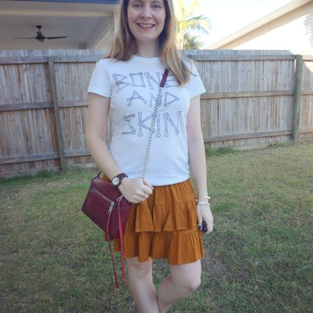First wearing of this adorable rust ruffle skirt. Just $1 from the opshop 🧡 as it was such a warm day the other week when I wore this kept it simple with the old Kisschasy band tee that was overdue another wear! I really liked the burgundy Rebecca Minkoff Avery crossbody bag against the burnt orange of the skirt too ❤🧡  ------------------- ------------------ --------------- ------------------ ----------------------  Screenshot this pic to shop the product details from the @liketoknow.it app, or click here: http://liketk.it/3odaG #liketkit #LTKaustralia #LTKitbag #Springstyle #bandtee #RebeccaMinkoff #everythingLooksBetterWithABag #everydaystyle #realeverydaystyle #wearedonthestreet #realmumstyle #nevervainalwayscolour #mumlife