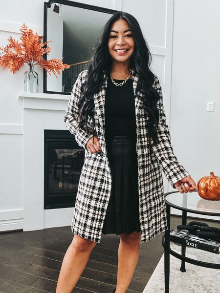 A pleated faux leather skirt is a must have for fall!