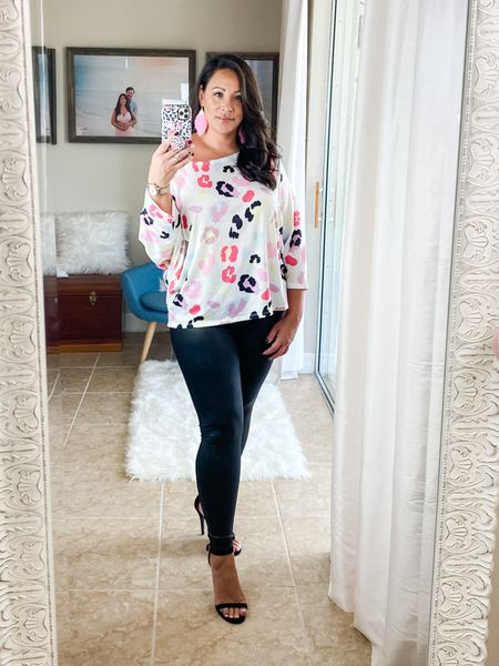 Super fun, neon bright, leopard print, batwing tee. Wearing size XL, I sized up in this top for an oversized fit. These leather leggings are awesome, I've worn them for almost a year. I sized up in the leggings for a looser fit, not skin tight. They are high waisted and are dupes for the spanx. http://liketk.it/2U9HA #liketkit @liketoknow.it #LTKcurves #LTKstyletip #LTKunder50
