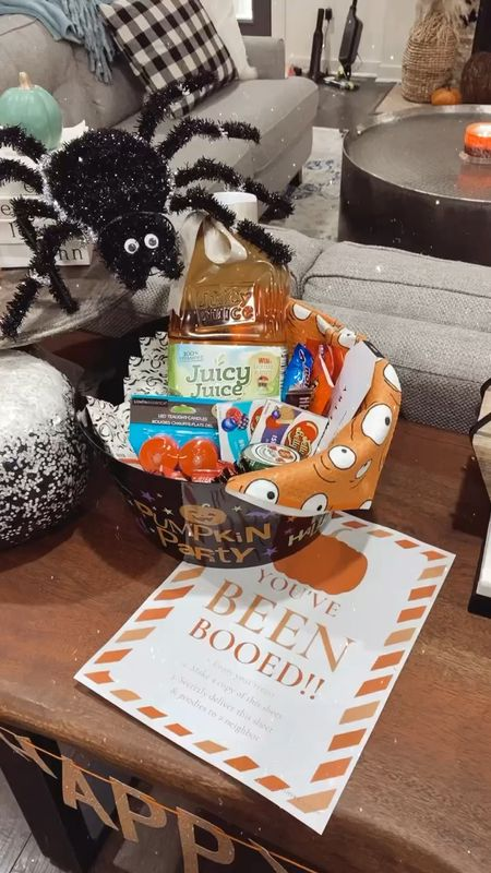 Cute halloween boo basket for our neighbors. 🧡 Sharing what I am putting in our goodie basket — tons of snacks and drinks to enjoy this fall + give to neighbors on a budget!   #LTKfamily #LTKHoliday #LTKhome