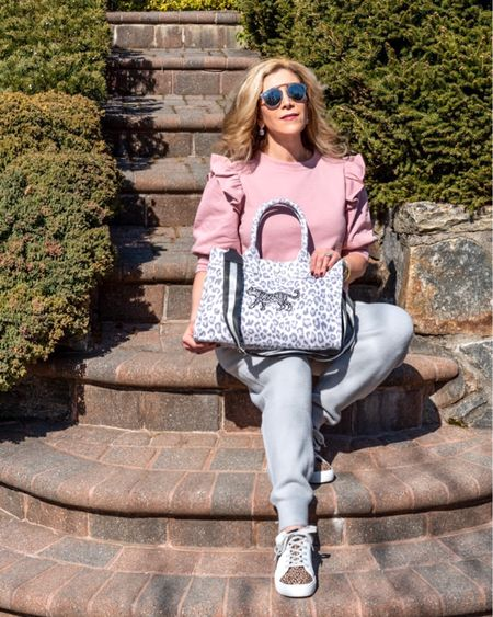 Is there any such thing as too much leopard? I think not! I'm obsessed with this @qulitedkoala Midi East  West bag with an added customized leopard. Save 20% on your own Quilted Koala bag by using the code FOUNTAIN. http://liketk.it/3fePR #liketkit @liketoknow.it #LTKitbag #LTKstyletip