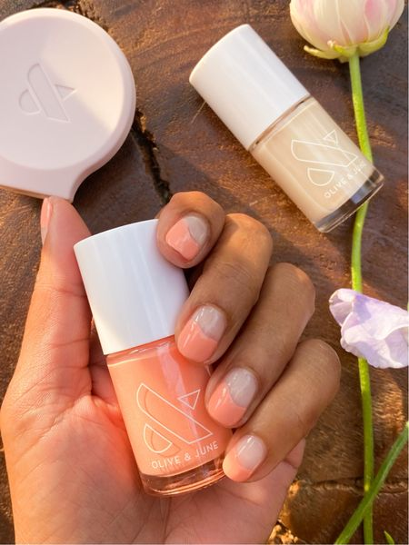 """It's National Nail Polish Day! 💅🏽Here's a negative space """"wavy"""" manicure for you!   One of the cool things about these mani's is that you won't notice grow out as much. 🙌🏾 If you're new to DIY manis, you will LOVE The Poppy tool which makes it sooooo easy to do your dominant hand- and you can use it on most polish brands!   You can find everything at Target, which is convenient since we're already shopping there for our jeans, dresses, and of course, Target Beauty! Linked everything for you in stories (go see the tutorial!) and my Like to know it!  #targetstyle @target  @targetstyle #targetpartner  http://liketk.it/3gAH6 #liketkit @liketoknow.it"""