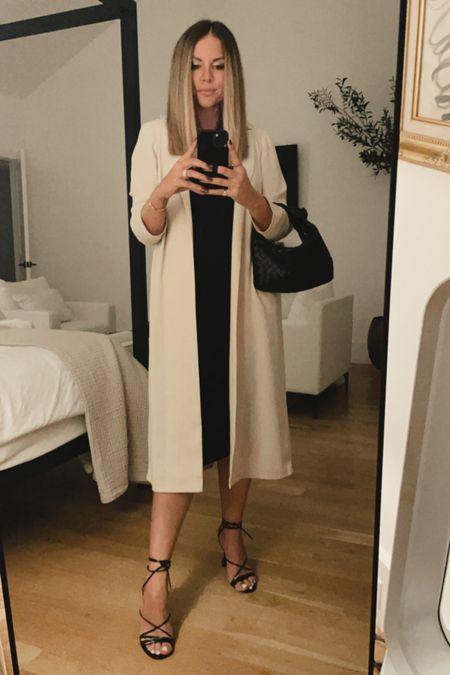 Black dress / heels / leather bag