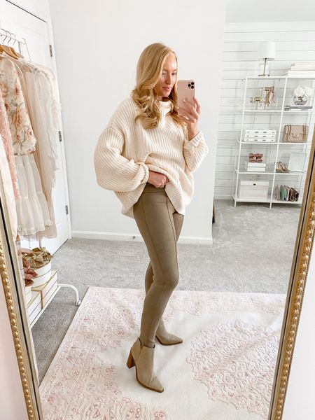 Can't wait to style the new Spanx faux suede leggings for fall! Wearing a medium here with a oversized free people sweater and booties. Use my code AMANDAJOHNxSPANX for 10% off!