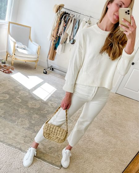 Casual summer outfit for an errand or the beach (if it's breezy, that is!). Everlane sweater is old but I linked similar lightweight sweaters for summer. White Levis fit TTS, so do the Common Projects sneakers!  Summer sweater, white straight leg jeans, white sneakers, woven bag, woven crossbody bag #casualsummeroutfit #lightweightsweaters #whitelevis #commonprojectssneakers