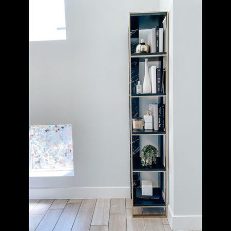 Modern shelving. Bookshelf. Black marble and gold shelf. Shelf styling. Bathroom decor   #LTKstyletip #LTKhome