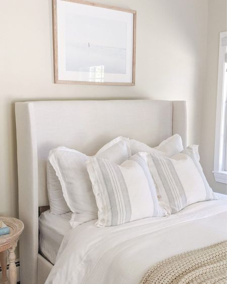 Our bed is currently almost 40% off right now, and this artwork which arrived over the weekend has added such a calming feel to our guest room! Side table is no longer in stock, but I linked a couple of affordable nightstand options! - coastal decor, beach house decor, beach decor, beach style, coastal home, coastal home decor, coastal decorating, coastal interiors, coastal house decor, home accessories decor, coastal accessories, beach style, blue and white home, blue and white decor, neutral home decor, neutral home, natural home decor, guest bedroom, guest bedding, guest room bedding, guest room ideas, upholstered bed, full size bed, queen size bed, king size bed, California king bed, white duvet cover, pottery barn bedding, blue and white pillow shams, Euro pillow shams, white linen shams, serena and lily pillow covers, 20x20 pillow covers, linen pillow covers, white Euro shams, bedroom decor, bedroom furniture, coastal bedroom, nightstand decor, white sheets, master bedroom, master bedroom ideas, master bedroom decor, coastal artwork, large artwork, living room artwork, coastal art, coastal prints, coastal art prints, prints decor, prints on a wall, large art prints, large artwork,, wall art large, blue artwork, beach house artwork, beach artwork, surfer artwork, framed prints, artwork for bedroom, bedroom artwork, calming artwork, coastal nightstands   #LTKfamily #LTKsalealert #LTKhome