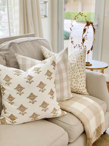 Neutral fall throw pillows and Buffalo checked throw. Use these gold wreaths on a stand for a fun color pop.  #LTKstyletip #LTKSeasonal #LTKhome