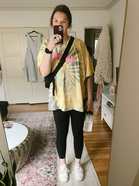 Comfy / casual outfit. Vintage Supply oversized T-shirt in tie-dye with graphic print from ASOS, fall / winter, spring / summer, working out, fitness, exercise, Reebok sneakers, black Fanny pack, spanx every wear active icon leggings, girlfriend collective sports bra, Athleta, on sale, budget friendly, claw clip from Amazon, under $15, gold jewelry / earrings from nasty gal  #LTKunder50 #LTKunder100 #LTKfit