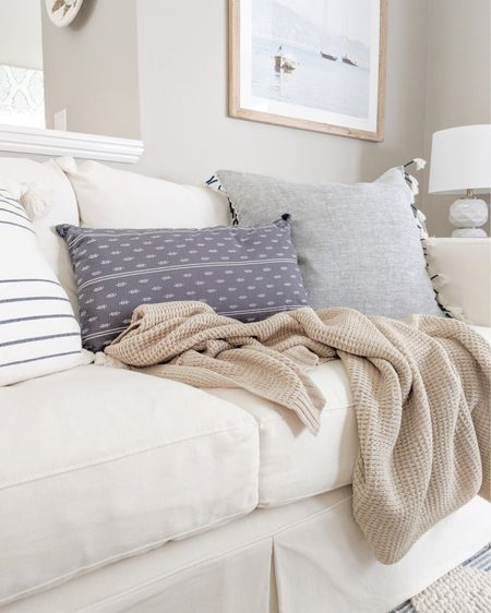 """That nighttime chill in the air has definitely arrived, and I love nothing more than to snuggle up on the couch in the evening under a cozy throw blanket! -  home decor, decor under 50, home decor under $50, fall decor, fall decorations, fall home decorations, coastal decor, beach house decor, beach decor, beach style, coastal home, coastal home decor, coastal decorating, coastal interiors, coastal house decor, home accessories decor, coastal accessories, beach style, blue and white home, blue and white decor, neutral home decor, neutral home, natural home decor, serena & lily pillows, serena and lily throw pillows, fall throw blanket, blue and white pillows, blue and white lumbar pillows, coastal throw pillows, 26"""" throw pillow, 20"""" throw pillows, blue and white striped throw pillows, throw pillows with tassets, textured throw pillows, white couch, white slipcover couch, textured rug, blue and white rugs, serena & lily rugs, living room decor, coastal living room, living room furniture, couch throw pillows, textured throw blanket, neutral throw blanket, crate & barrel couch, crate & barrel sofa, willow sofa, willow couch, coastal artwork, large artwork, living room artwork, coastal art, coastal prints, coastal art prints, prints decor, prints on a wall, large art prints, large artwork, small art, wall art large, blue artwork, 30x40 artwork, 30x40 prints, sailboat artwork, sailboat print, coastal photography, fall living room  #LTKstyletip #LTKhome #LTKfamily"""