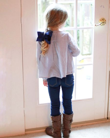 This girl....seeing a glimpse of her standing there upset it's raining out...she looks so old!!! She's wearing an outfit I'd wear...tall boots, skinny jeans, embroidered floral shirt, a simple braid. It hit me that it's exactly 6 months from today that she starts Kindergarten. I won't have my bestie home for five days a week!! We do so much together and she's such a little mama so she's always wanting to help. I just can't believe how fast time is going! Stay little a little longer my little bestie!💕👯♀️ I linked up her outfit and boots for you...it's really the cutest! Just screenshot this pic and open the @liketoknow.it app to see the sources, and follow me there!  http://liketk.it/2uKq2 #liketkit #LTKkids