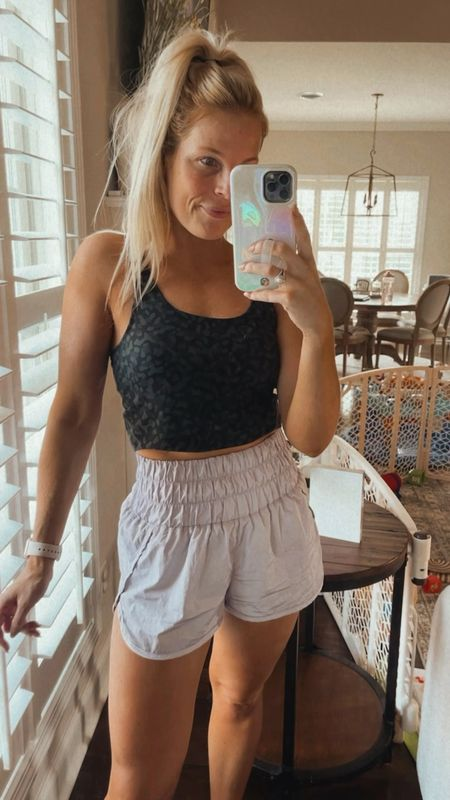 Shop today's workout outfit! Lululemon dupe tank from Amazon & my favorite shorts from Free People! I wear size small in both! #athleisure #workout   #LTKunder50 #LTKfit