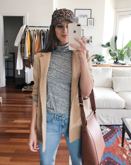 PSA!! The leopard hat is back in stock AND on sale!! As are my favorite tissue turtleneck tees! My sweater blazer is sadly not on sale but totally worth every penny-one of the most versatile pieces you'll own this season! Jeans are Everlane and run TTS-and my messenger back is awesome for commuters-fits a laptop perfectly! http://liketk.it/2xExs #liketkit @liketoknow.it