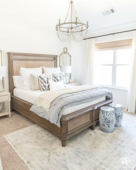 A blue and white bedroom is perfect for guests! Home deco bedroom decor white bedding beaded chandelier garden stool mirror pair  #LTKhome #LTKstyletip