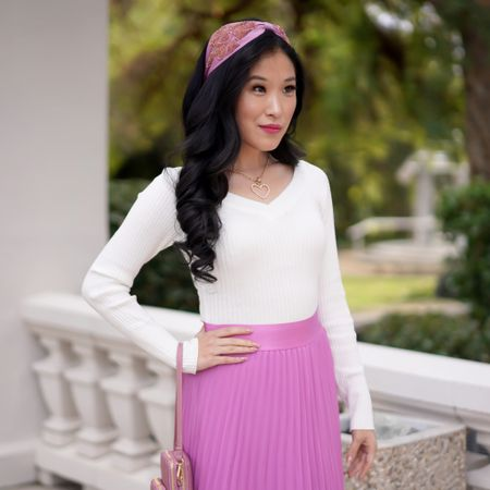 Valentine's Day Look! You will love this Valentine's Day pink look! Pair a white long sleeve bodysuit with a pink orchid midi pleated skirt and matching pink heart headband! Style the look with your favorite heart necklaces!   #LTKVDay http://liketk.it/37Fqr #liketkit @liketoknow.it     Follow me on the LIKEtoKNOW.it shopping app to get the product details for this look and others