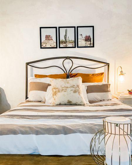 Bedroom makeover with earth tones and a boho southwest desert chic vibe! Beige Duvet set, Burt orange velvet Euro pillows, gold lantern, modern gold lamp, desert cactus boho prints, and a gold cowhide accent pillow 💛🧡  http://liketk.it/2TYer #liketkit @liketoknow.it @liketoknow.it.home #LTKhome #LTKunder50