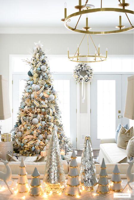 Christmas decor and Christmas tree in an elegant palette of silver, gold and light blue.  #LTKSeasonal #LTKHoliday #LTKhome