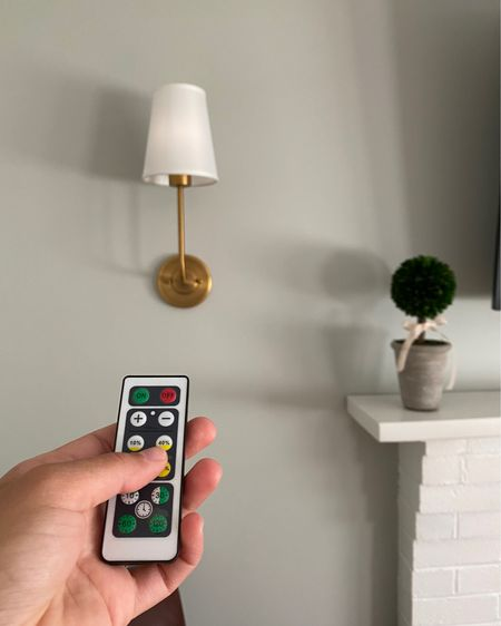 The easiest DIY you ever did do! Shop this set of sconces under $100 and the set of remote pick lights under $20 for this elegant and simple home decor trick. @liketoknow.it #liketkit http://liketk.it/3iiTj #LTKunder100 #LTKunder50 #LTKhome @liketoknow.it.home Shop my daily looks by following me on the LIKEtoKNOW.it shopping app