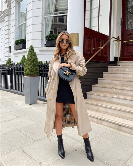 Styling a vintage burberry classic trench coat with a black mini skirt and mid calf pointed boots for a classic, timeless autumn outfit  .   #LTKunder100 #LTKstyletip #LTKSeasonal