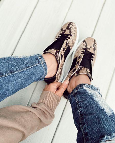 Snakeskin sneakers & distressed denim!  http://liketk.it/3cxxJ #liketkit @liketoknow.it #LTKSpringSale #LTKstyletip #LTKshoecrush