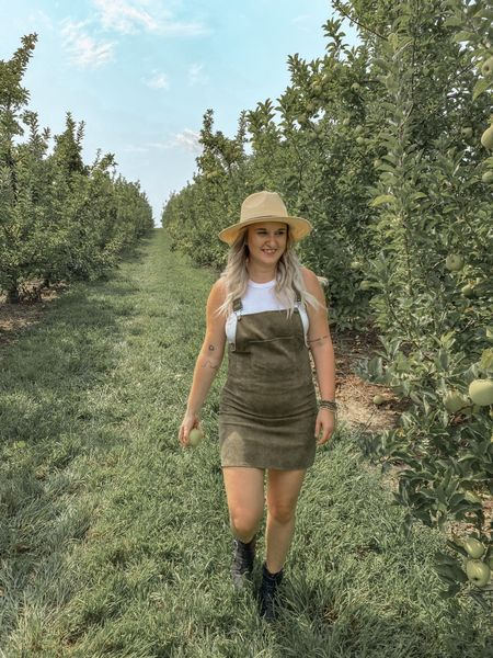 Loved going Apple picking in my Army Green corduroy overall dress! It was hot that day so I paired a high neck ribbed tank under it and added my black cowboy studded booties and a fedora sun hat. Perfect transitional fall look! I couldn't find the exact booties but I linked a similar pair! The are on a major sale right now!  #LTKfall  #LTKsalealert #LTKshoecrush #LTKunder50