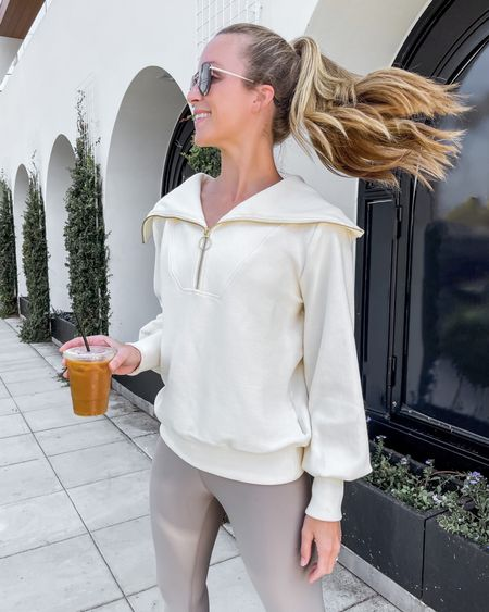 Easy early fall coffee run look. This half zip has been a favorite for weeks and has detailing that makes it worth the price point. Fits true to size and so do the alo yoga leggings. #fallworkout #aloyogaleggings #halfzipsweater #fallathleisure