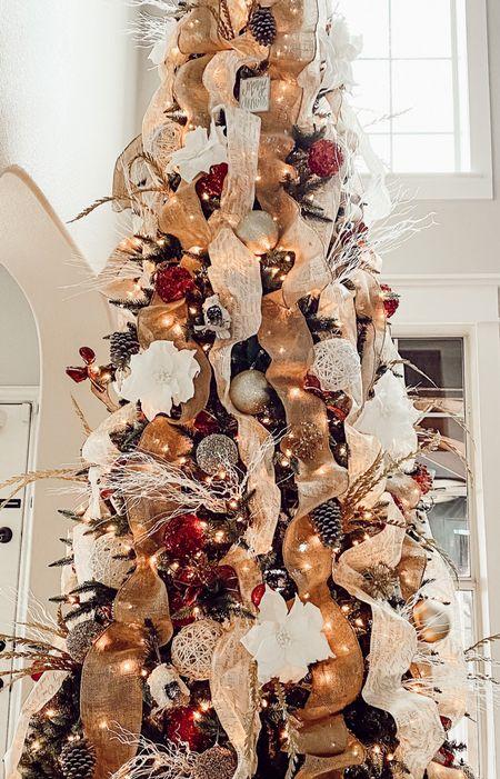 Having a 16' tree isn't easy to decorate but it sure is beautiful! 😍✨  https://ltk.app.link/k0NSsjzSlcb #ltk #liketkit @liketoknow.it #christmas #decor #christmastree #styling #interiors #homedecor #interiordesign  #LTKstyletip #LTKhome #LTKunder100