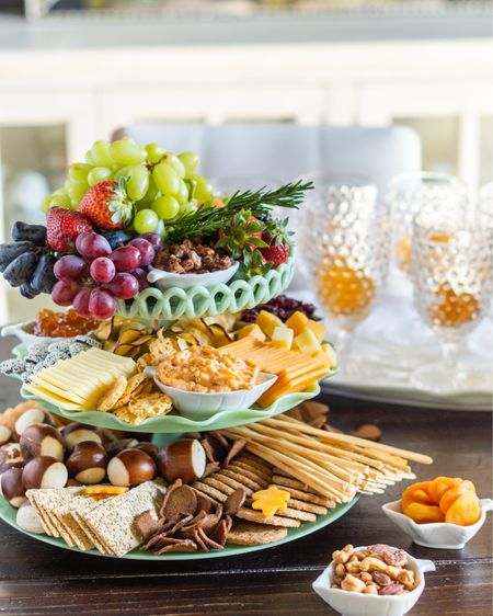 """Charcuterie boards are always a hit but what about a charcuterie TOWER? (#MarthaStewartPartner) When I saw these pretty jadite cake stands and platters on Martha.com, I loved them on their own but I couldn't wait to get my hands on them to test out my concept. And… confirmed – it's like they were meant to be ;) And, because I'm a believer in proven classics, I decided to use my ingredients two ways – one tiered vertical, and one classic """"board"""". Except… I couldn't decide which pretty white leaf platter to use, so I used both, haha. Tip: I used pre-cut cracker cheese and cubes for grab-and-go-style-grazing so there's no cutting necessary on the tiered tower!   Over on stories, you can see footage of me creating and assembling each of these, plus, a start-to-finish video of transforming that pretty, white pumpkin tureen into a fall statement centerpiece. In stories, you'll also find links for everything you see from the platters, cake stands, and hobnail goblets, to the cute leaf tidbit dishes and even-prettier-in-person lit oak and acorn wreath ;) Here's to the best entertaining season of all!   @marthastewartshop #marthastewart #charcuterieboards #cheeseboards #charcuterie #fallentertaining Thanksgiving cheese board dining room decor kitchen decor hostess #ltkunder50   #LTKHoliday #LTKSeasonal #LTKhome"""