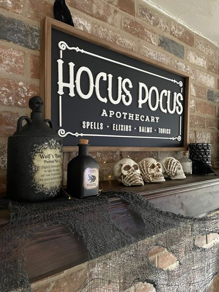 Halloween home decor. The Hocus Pocus Apothecary sign is at Kirkland's on sale.  The see no evil, hear no evil skulls, apothecary jars, and skull candle are At Home.  Couldn't link.    #LTKsalealert #LTKhome