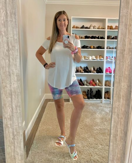 Was on the hunt for a long white tee to pair with leggings + biker shorts. I landed on this cold shoulder cutie which comes in 10 colors + is on sale for under $20! 🥳 Plus, I linked plenty of tie dye biker shorts.   #LTKsalealert #LTKfit #LTKunder50