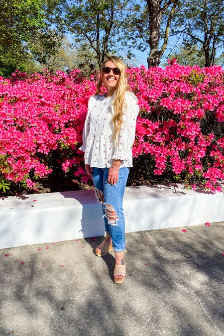 Affordable Spring outfit idea  Feline ruffle sleeve top with Mom jeans, cork wedges, and blue handbag      http://liketk.it/3gzpN #liketkit @liketoknow.it #LTKshoecrush #LTKtravel #LTKunder50