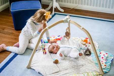 Lovevery play gym is amazing it comes with a booklet that teaches you how to play with your child based off of their monthly development and milestones. They also have monthly/milestone play kits for babies and kids   #LTKbaby #LTKfamily #LTKkids