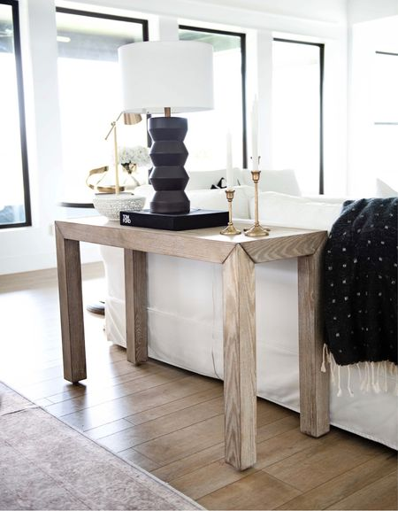 I love this console table! It adds warmth behind my sofa in our living room! I also love more surfaces to be able to put lamps and decor on for the fall!  Home decor, living room decor, entry consul, sofa table, black lamp, throw, fall decor, white decor, black Decor, washable rug, neutral rug, modern Decor, Restoration hardware, Pottery Barn  #LTKstyletip #LTKhome #LTKSeasonal