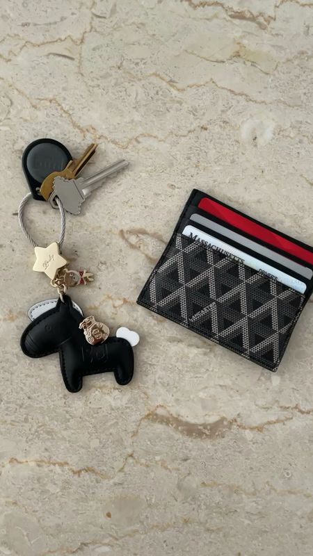 Adorable keychain. Well made. Came well packaged. Shown with my Lancaster Paris Ikon signature card holder for size reference.