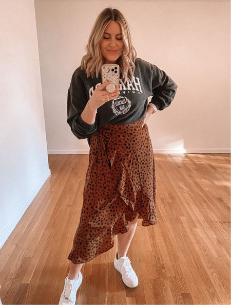 $16 midi skirt, perfect for Fall! Wearing M. Cut this H&M sweatshirt to a crop length (exact from last season but linking similar!)   Fall outfit idea, fall outfit