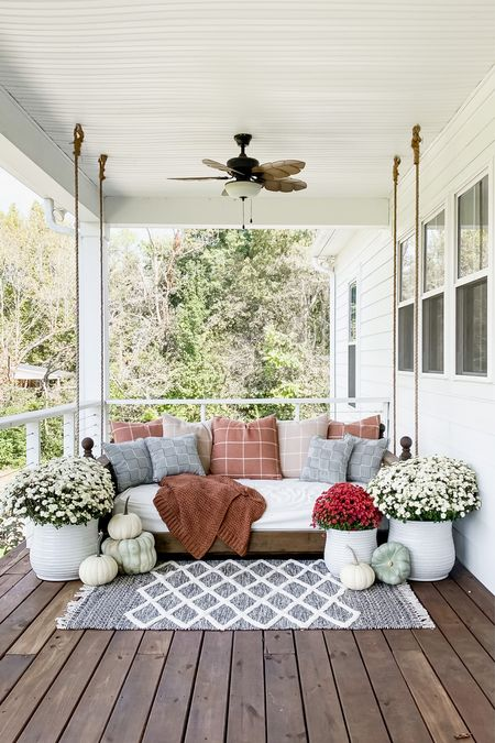 Farmhouse front porch decor. Bed swing porch swing blankets pillows ceiling fan light fixture planters outdoor living spaces home decor  #LTKhome #LTKHoliday #LTKSeasonal
