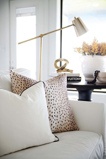 Neutral Home Decor Finds  living room decor, neutral pillow, Antelope pillow, animal print pillow, white pillow, black trim, black-and-white home, coffee table book, side table, side table Decor, TJMaxx,  Louis Vuitton, target home, target Finds, cantilever brass floor lamp, oversized side table, black Furniture, Living Royal Furniture, living room rug, black and white rug, Pottery Barn slipcovered sofa, white sofa, white home decor,  #LTKfamily #LTKhome #LTKstyletip