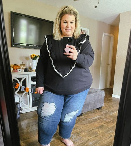 This plus size sweatshirt is a Walmart fashion find that would be so cute to pair with orange as a Halloween outfit! Would also just be cute for any plus size fall outfit!   #LTKSeasonal #LTKcurves #LTKunder50