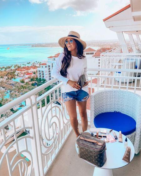http://liketk.it/3gKfx #liketkit @liketoknow.it vacation outfits, beach bag, Louis Vuitton, summer fashion, summer 2021, shorts, hats, sunglasses, Emily Ann Gemma